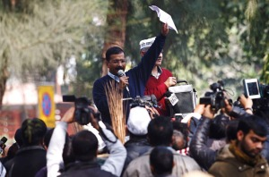 Delhi's Chief Minister Kejriwal, leader of the Aam Aadmi (Common Man) Party, addresses his supporters during a protest in New Delhi