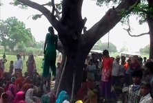 Video still shows two girls hanging from a tree in a village in the northern Indian state of Uttar Pradesh